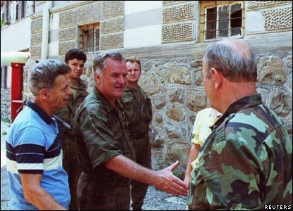 Mladic (C) shakes hands with a Bosnian Serb army soldier in the eastern Bosnian town of Srebenica July 13. Bosnian Serb forces took control of the town late July 11, 1995