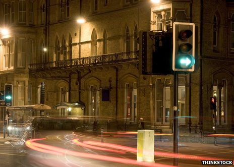 Street scene at night with traffic lights