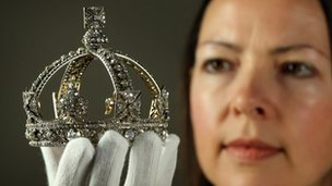 Caroline de Guitaut, Curator of Royal Collections, holds Queen Victoria&#039;s small diamond crown from 1870 at The Queen&#039;s Gallery, Buckingham Palace