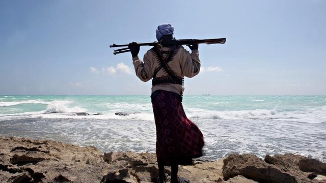 Somali pirate along the coastline