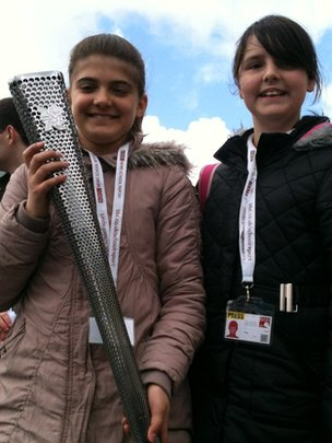School Reporters holding Paralympic Torch