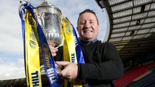 Hearts hero John Robertson poses with the Scottish Cup