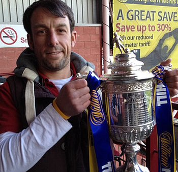 Simon Rennie poses with the Scottish Cup