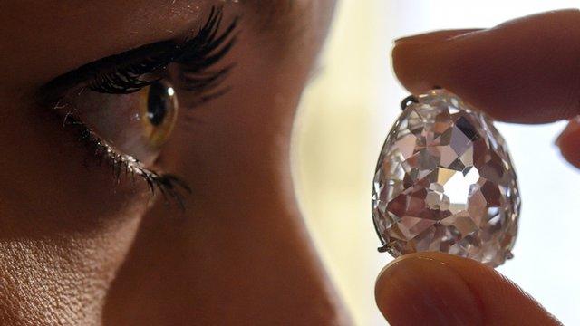 "Model poses with the Beau Sancy diamond during a Sotheby""s auction press preview in Geneva"
