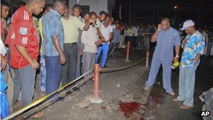 People gather at the site of an explosion outside the Bella Vista nightclub in Mombasa, Kenya, late on Tuesday