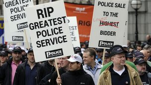 Police Federation members march during a protest in London