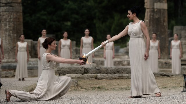 The Olympic Flame is lit in Olympia, Greece, by the Vestal Virgins