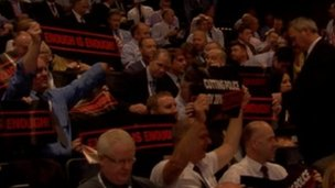 Officers hold up placards at Police Federation conference
