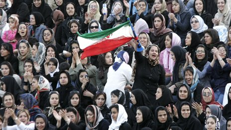 Women cheer at a friendly football match in Tehran in 2006
