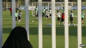 A woman looks at Iran's national football team practice in Tehran (2006)