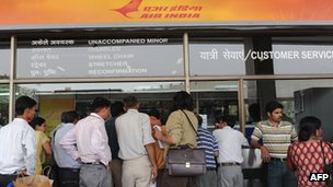 Customers at an Air India counter