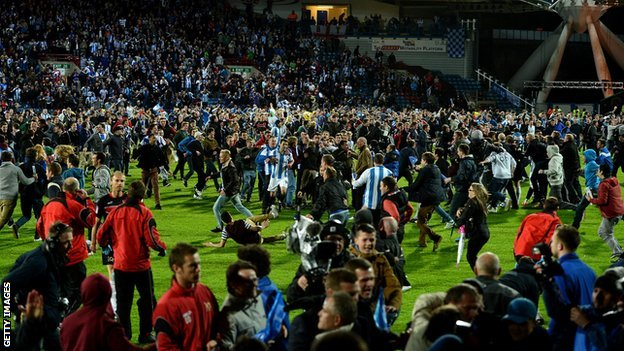 Huddersfield Town fans invade the pitch