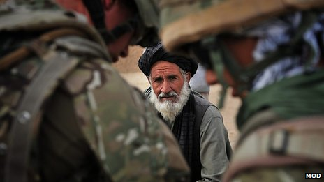 QDG forces talk to village elder in Afghanistan