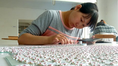 A worker making costume jewellery