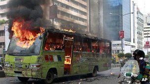 Bus set on fire by suspected activists of opposition Bangladesh Nationalist Party (BNP) in Dhaka, Bangladesh, Wednesday, May 16, 2012.