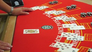 A student practices a game of Baccarat