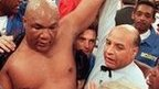 George Foreman wins the title again in 1994