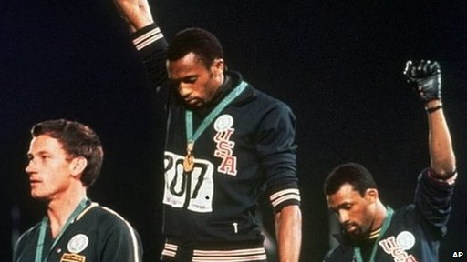 Tommie Smith and John Carlos controversially give a black power salute at the 1968 Mexico Olympics