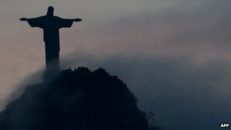 Christ the Redeemer statue overlooking Rio de Janeiro at sunset on 24 April 2012