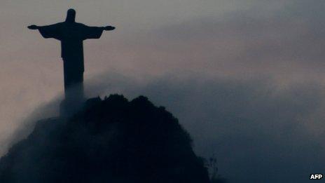 Christ the Redeemer statue overlooking Rio de Janeiro at sunset on 24 April 2012