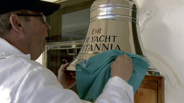 Crewman polishes a bell on the Royal Yacht Britannia