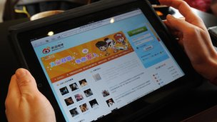 A user looking at the Weibo website on a tablet PC