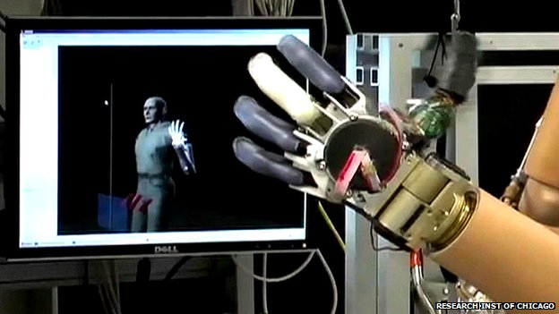 robotic hand in front of screen