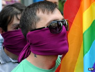 Gay rights activists with a rainbow flag in Tbilisi, 17 May