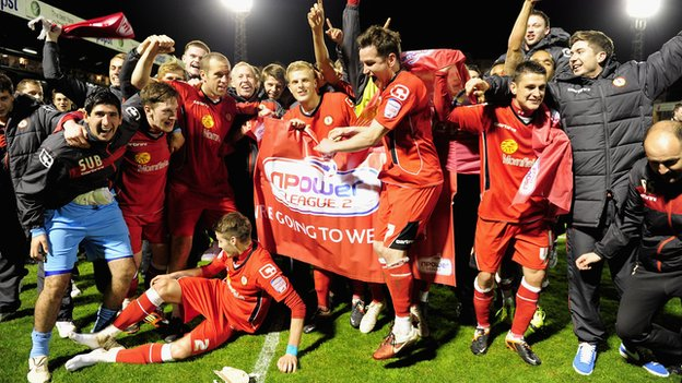 Crewe Alexandra players celebrate reaching Wembley