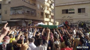 "Anti-government protesters attend the funeral of Mahmoud Al Moustafa, whom protesters said was killed by forces loyal to Syria""s President Bashar al-Assad, in Deir Al Zour, May 15, 2012"