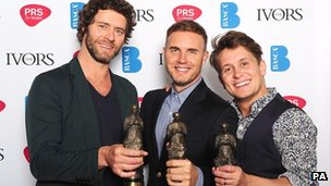 Howard Donald, Gary Barlow, and Mark Owen from Take That with the PRS For Music Outstanding Contribution to British Music award at the 2012 Ivor Novello awards