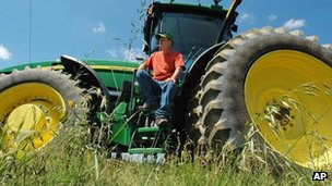 Farmer sits on tractor