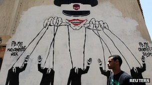 Egyptian poster depicts the ruling military council as manipulating the presidential election