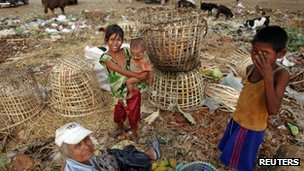 People search for usable items at a junkyard in Yangon, Burma May 16 2012