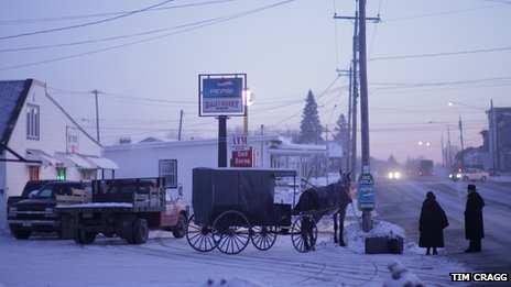 Amish people waiting for a bus in Canton, NY