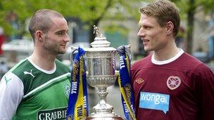 Hearts captain Marius Zaliukas (right) joins Hibernian captain James McPake