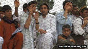 People watching a cricket match in Afghanistan
