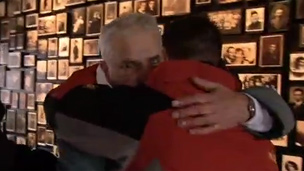 Zvika, holocaust survivor embraces Rainer Hess
