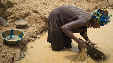 Woman panning for gold