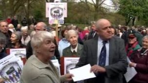 Protesters present council leader David Jones with a letter