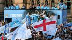 Manchester City leave Manchester Town Hall in an open top bus for the start of their victory parade around the streets of Manchester