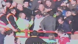 Darren Priaulx (centre, white top) is attacked