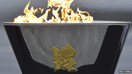 Olympic cauldron lit by David Beckham on the tarmac at RNAS Culdrose