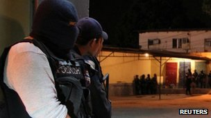 Policemen guard the outside of the prison in San Pedro Sula