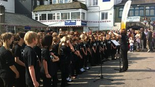 Falmouth & Penryn Schools Choir warming up ready to welcome the torch