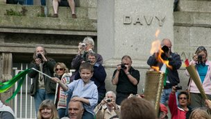 Flame in Penzance at Davy statue