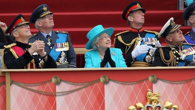 Chief of the Defence Staff General Sir David Richards, Queen Elizabeth II and Prince Philip, Duke of Edinburgh watch the flypast