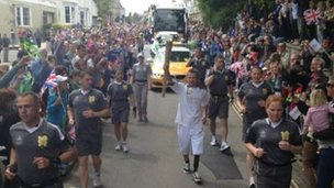 Rik Bennett carries flame into Truro