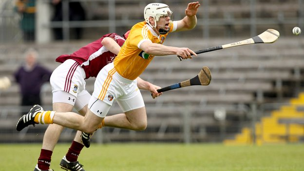 Antrim&#039;s Neil McManus battles with Westmeath&#039;s Aonghus Clarke