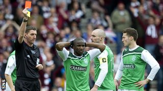 Hibernian's Pa Kujabi is sent off by referee Craig Thomson